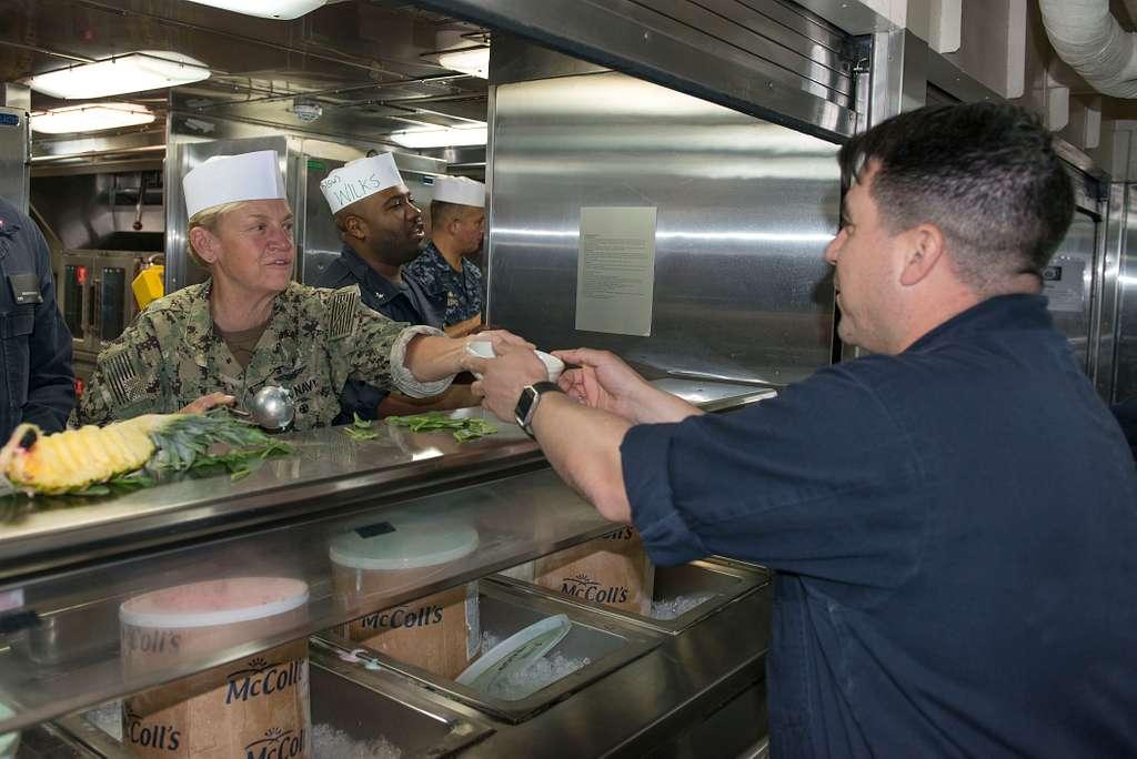 Vice Adm. Nora Tyson, left, commander of U.S. 3rd Fleet, serves ice cream during an ice cream social aboard the San Antonio-class amphibious transport dock ship USS Anchorage (LPD 23).