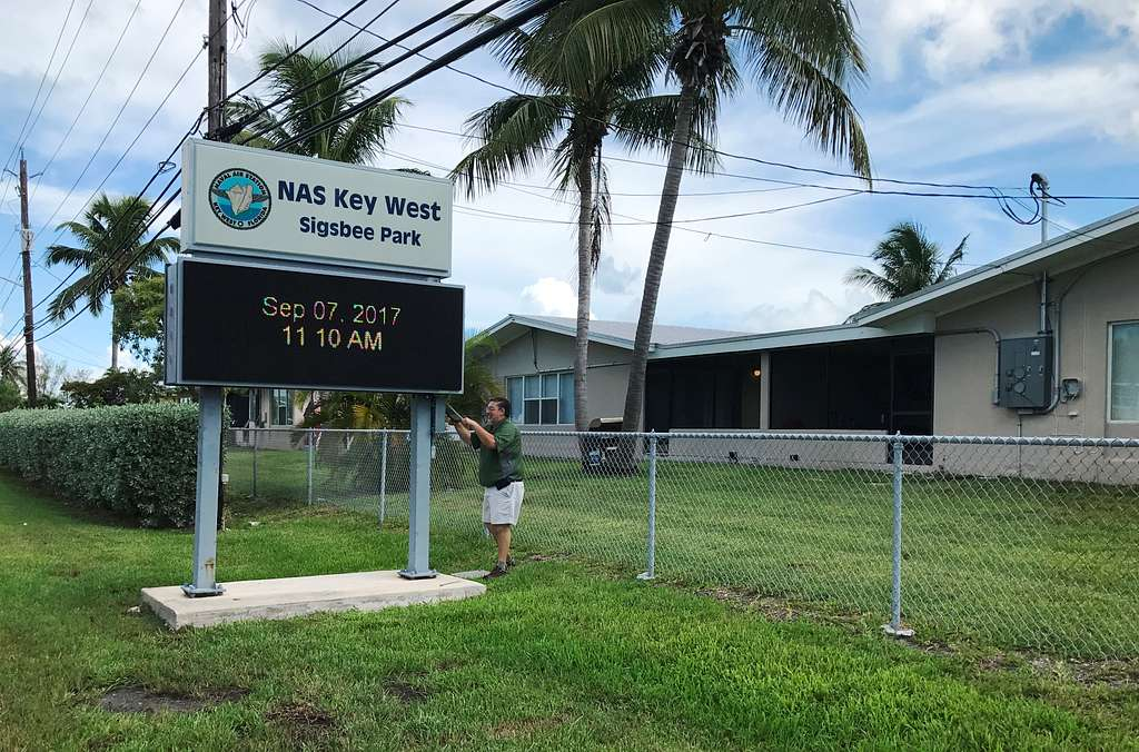 Naval Air Station Key West Morale, Welfare and Recreation Director Tim Campbell, from Elkhart, Indiana, secures the marquee to the evacuated Sigsbee Park Annex in order to preserve the unit ahead of Hurricane Irma.