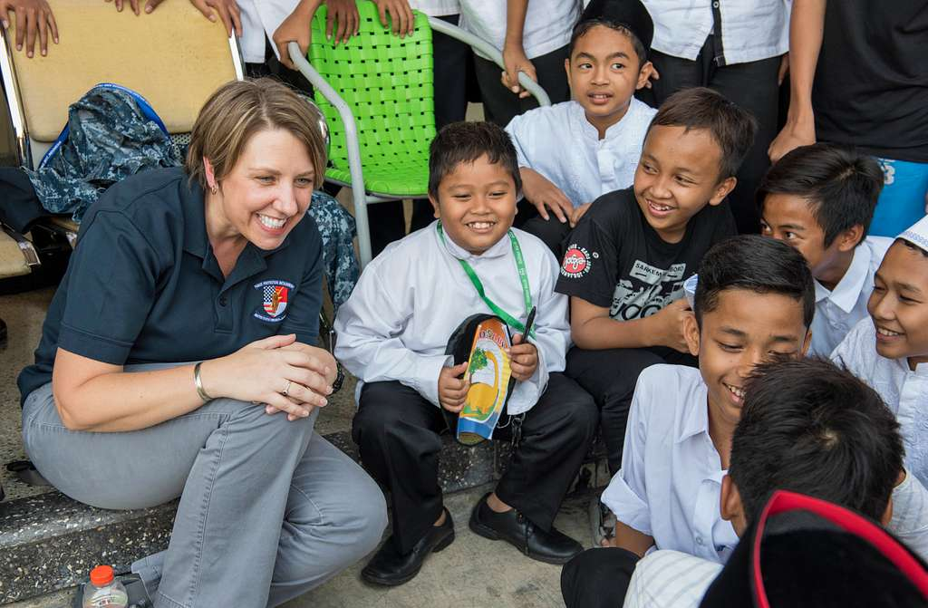 Special Agent Debbie Fasano, from the Naval Criminal Investigative Service (NCIS), U.S. Embassy Jakarta, interacts with students at a High School during Cooperation Afloat Readiness and Training (CARAT) Indonesia 2017 in Surabaya, Indonesia.