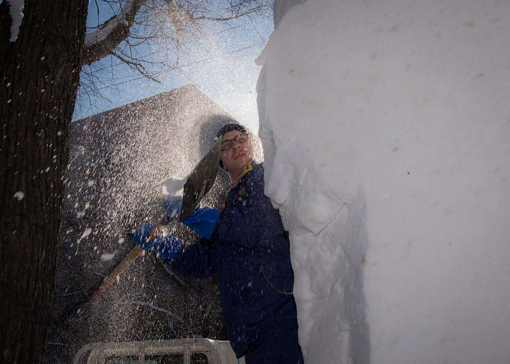 Builder Constructionman Kyle Antrobus, assigned to Public Works Department Far East, details the 2018 Navy Snow Team Sculpture for the 69th Annual Sapporo Snow Festival.