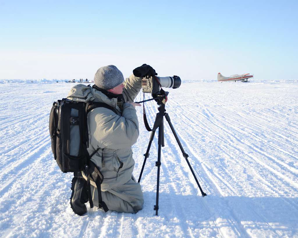 Petty Officer Aaeon Hoare, a royal navy photographer, captures the takeoff of an aircraft at Ice Camp Skate during the multinational maritime Ice Exercise (ICEX) in the Arctic Circle.