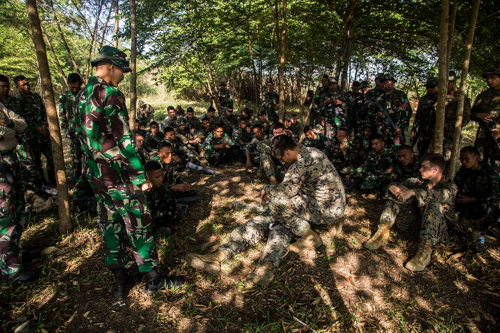 Hospitalman Lucas Stein, Platoon Corpsman with Kilo Company, 3rd Battalion, 3rd Marines demonstrates medical tourniquet procedures to U.S. and Indonesian Marines during the KORMAR Platoon Exchange 2018.