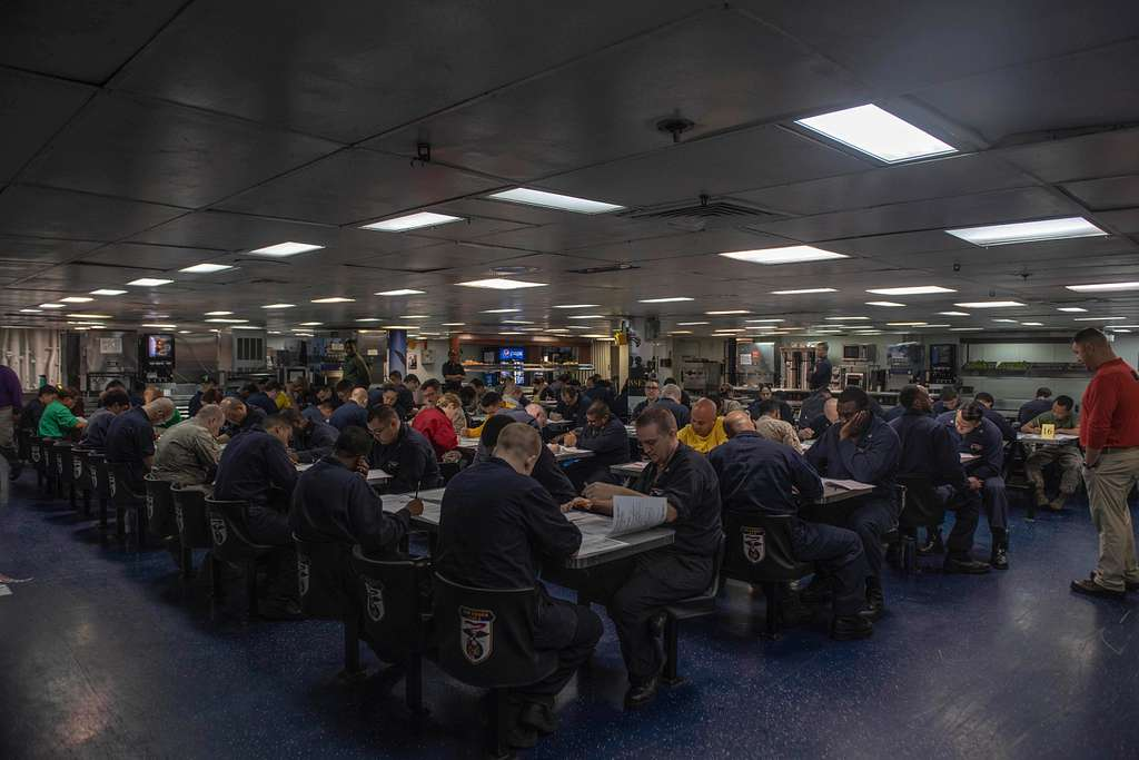 Sailors take the Navy-wide petty officer first class advancement examination aboard the Wasp-class amphibious assault ship USS Essex (LHD 2) during a scheduled deployment of the Essex Amphibious Ready Group (ARG).