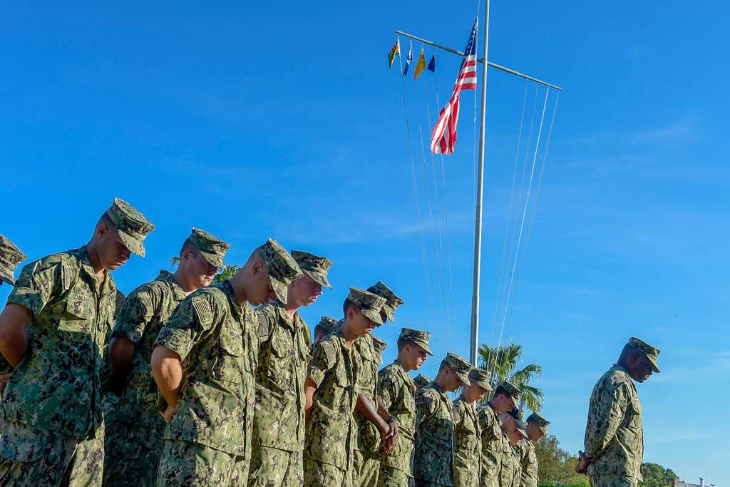 Students from Information Warfare Training Command (IWTC) Corry Station bow their heads during a 9/11 remembrance ceremony conducted by chief petty officer selectees from IWTC Corry Station