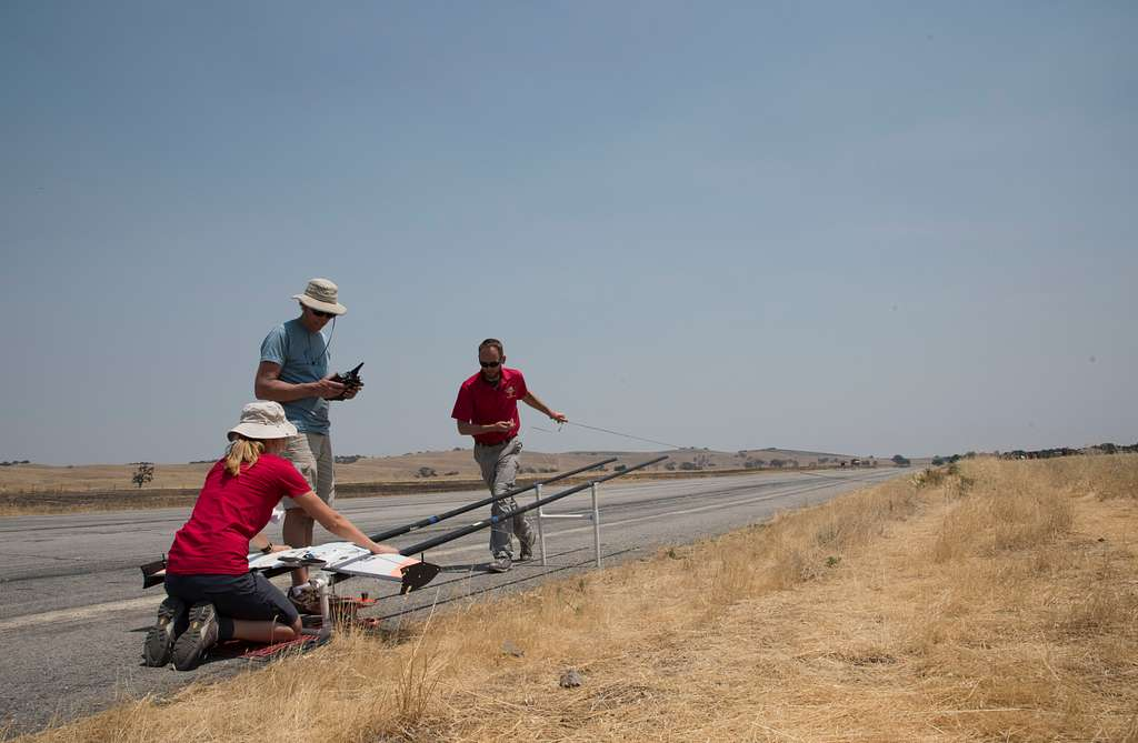 A team of researchers from the Naval Postgraduate School prepares to launch an unmanned aerial vehicle during an experiment in swarming unmanned systems at the latest Joint Interagency Field Experimentation (JIFX) program at Camp Roberts, Calif.
