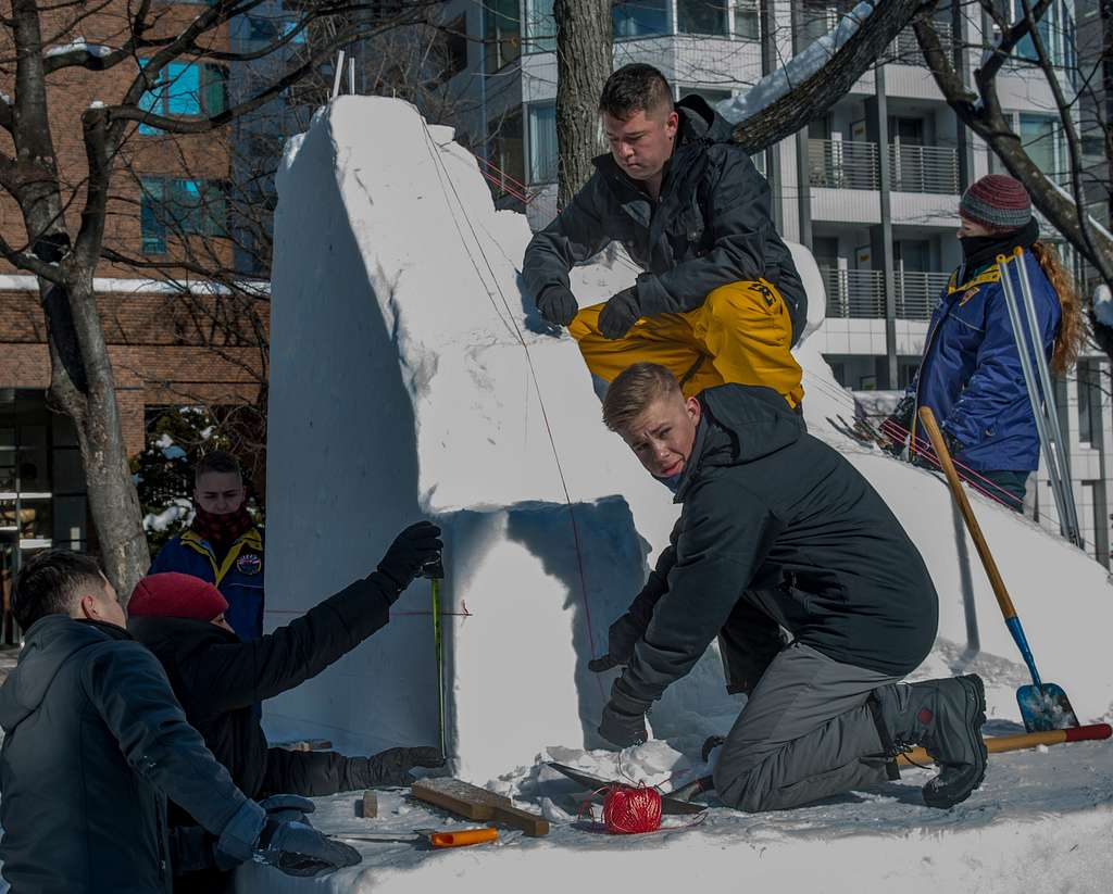 Sailors from the Navy Misawa Snow Team detail their sculpture during the 70th Annual Sapporo Snow Festival. Approximately two million visitors from around the globe visit the festival each year to see hundreds of snow and ice sculptures.