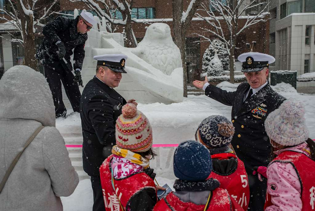 Sailors demonstrate parts of the construction and maintenance process behind creating the Navy Snow Team snow sculpture for the 70th Annual Sapporo Snow Festival.