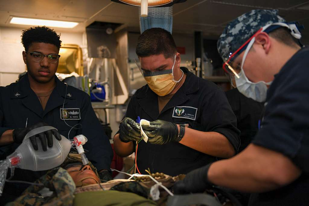 Sailors assigned to the amphibious assault ship USS Boxer (LHD 4) treat a patient in an operating room during a medical drill.