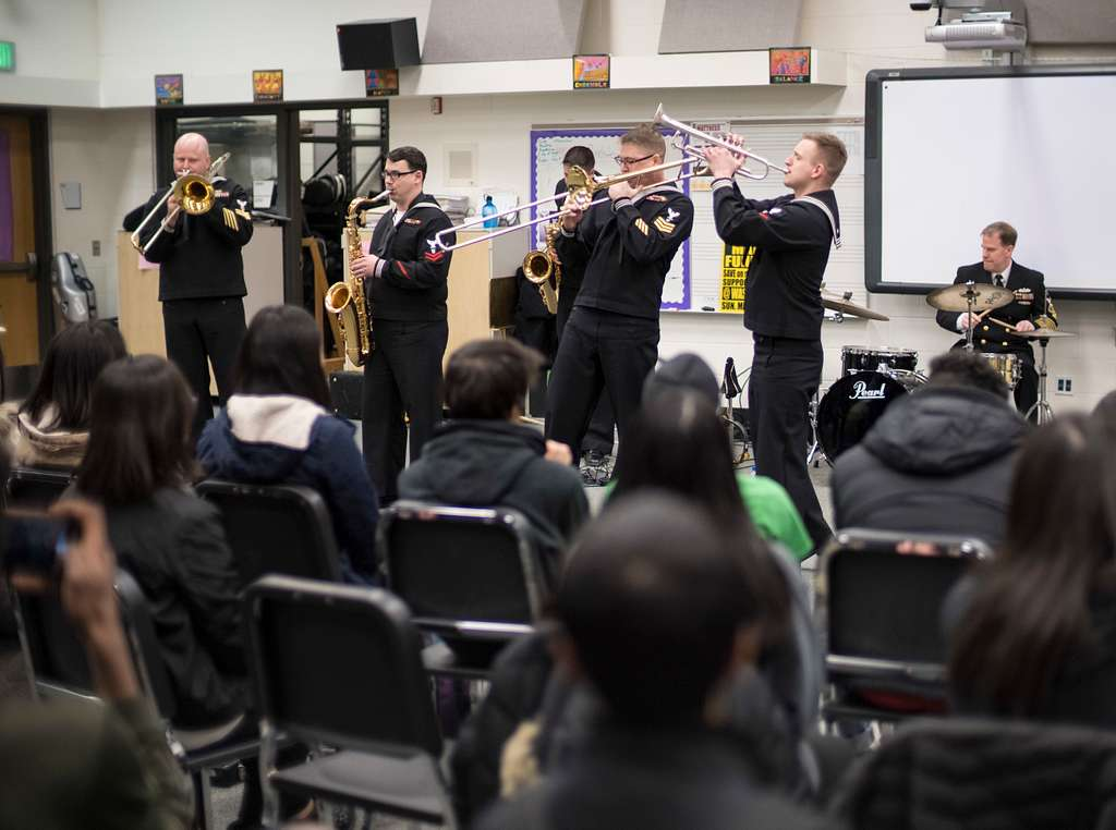 Musicians from Navy Band Northwest work with a music class at Washington Technology Magnet School during Navy Recruiting Commands' Swarm Minneapolis evolution,  teaching students about music and life as a Navy musician.