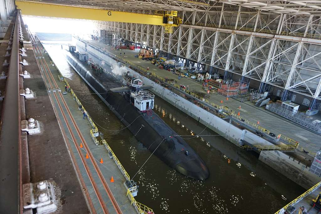 The Ohio-class guided missile submarine USS Georgia (SSGN 729) prepares to exit the dry dock at Naval Submarine Base Kings Bay, Georgia, following an extended refit period.