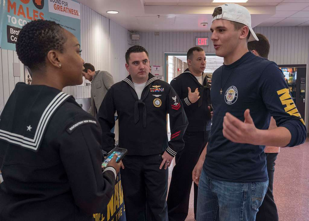 Recruiters talk to students at Framingham High School about opportunities in the Navy during a Navy Recruiting Command Boston Surge evolution.