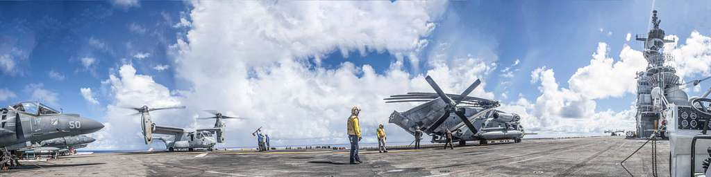 U.S. Marine Corps aircraft assigned to Marine Medium Tiltrotor Squadron (VMM) 163 (Reinforced), 11th Marine Expeditionary Unit (MEU), are staged aboard the amphibious assault ship USS Boxer (LHD 4) during flight operations.