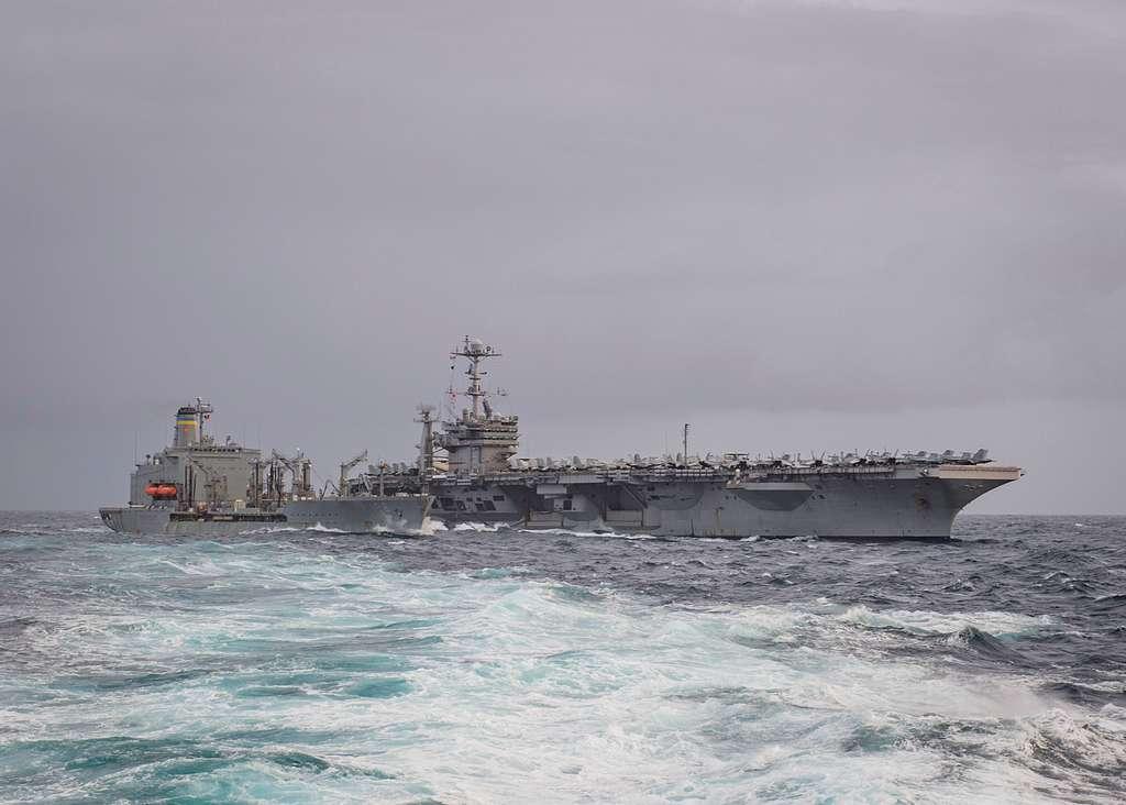 The Nimitz-class aircraft carrier USS Harry S. Truman (CVN 75) conducts a replenishment-at-sea with the fleet replenishment oiler USNS Big Horn (T-AO 198).