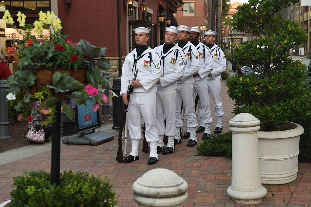 Members of the U.S. Navy Ceremonial Color Guard prepare for a public performance during Baton Rouge Navy Week.