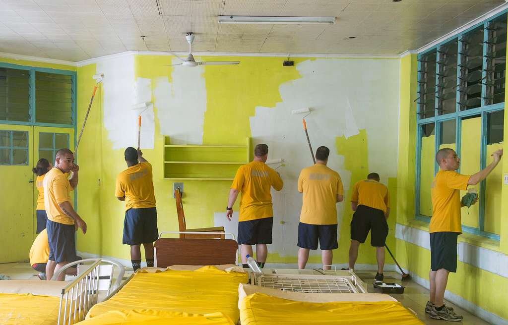 Sailors assigned to the guided-missile destroyer USS William P. Lawrence (DDG 110) paint a hospital for a community relations project during port visit to Suva, Fiji.